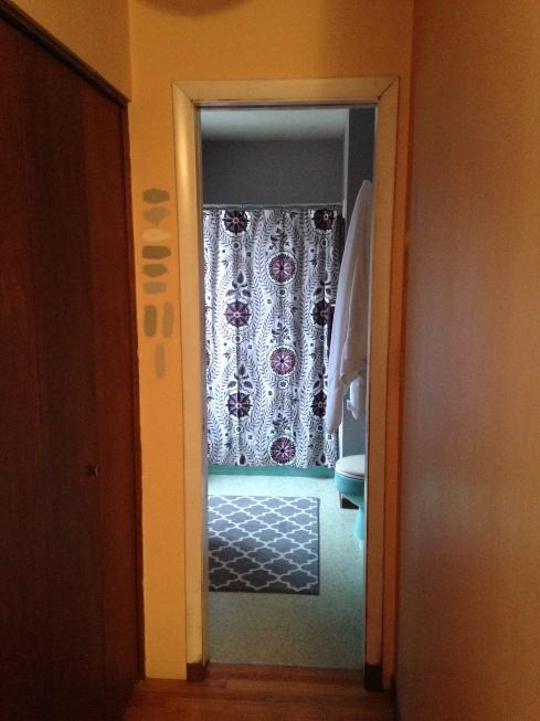 A look at the bathroom through the pocket door.