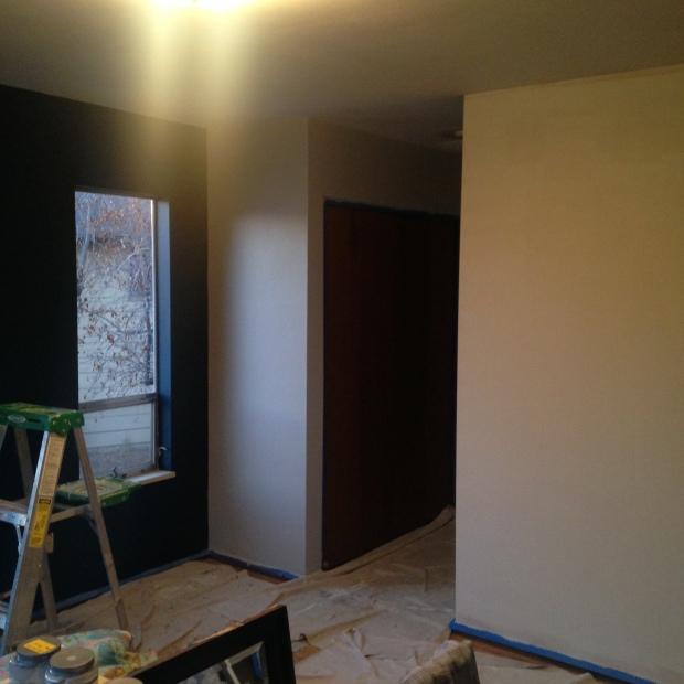 Navy blue wall in master bedroom