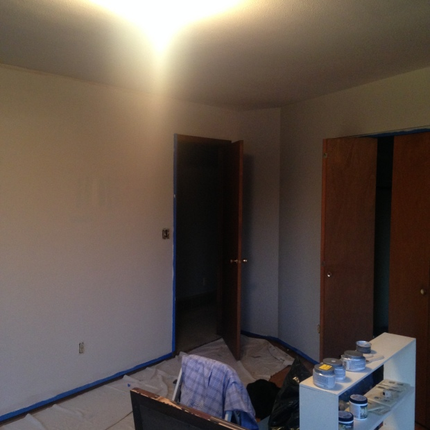 Master bedroom in progress with gray paint