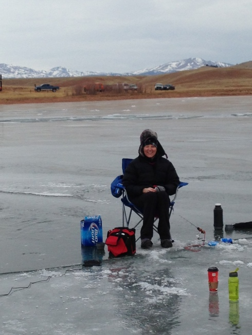 Ice fishing and guarding the Bud Lite
